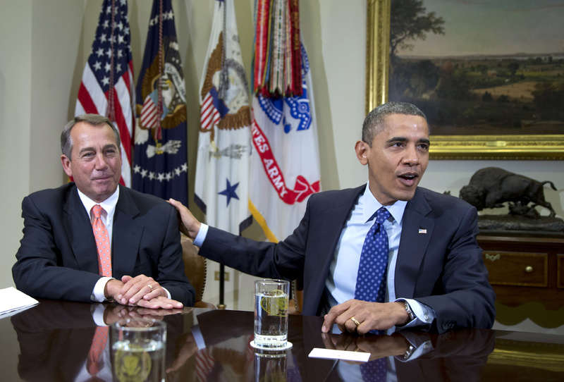 President Obama acknowledges House Speaker John Boehner of Ohio while speaking to reporters in the Roosevelt Room of the White House in Washington on Nov. 16. Administration officials say Obama and Boehner met Sunday at the White House to discuss the ongoing negotiations over the impeding
