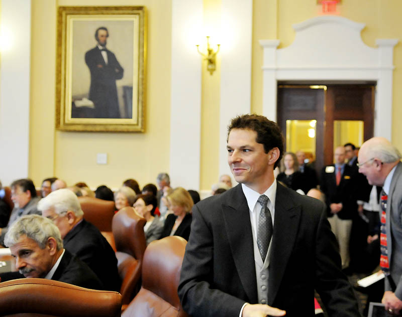 Sen. Justin Alfond, D-Portland, walks to the Senate president's podium on Wednesday after being confirmed by his colleagues in the Senate. All Senate and House members were sworn in for the 126th Legislature by Gov. Paul LePage.