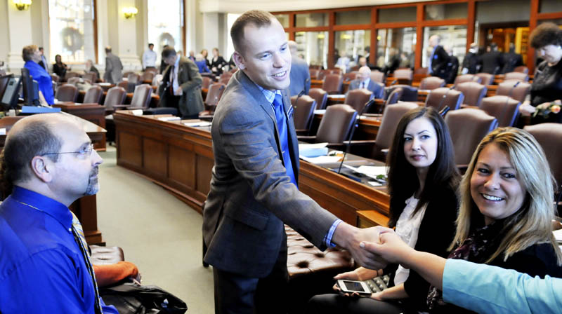 Corey Wilson, R-Augusta, greets well wishers Wednesday before taking the oath of office in the House of Representatives in Augusta.