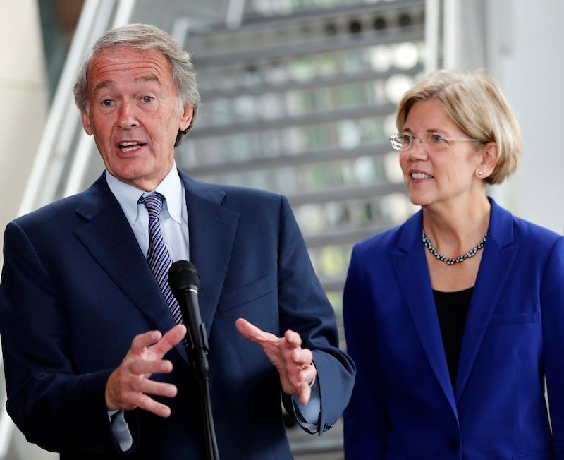 U.S. Rep. Ed Markey, D-Mass., left, accompanied by then-Democratic Senate candidate Elizabeth Warren, speaks with reporters as Warren campaigned in Medford, Mass. Markey said Thursday that he plans to run for John Kerry's Senate seat if Kerry is confirmed as the nation's new secretary of state.