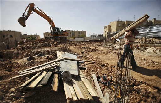 A Palestinian man works at a construction site in East Jerusalem in a 2010 file photo. On Monday, Israel said it was moving ahead with plans to build hundreds of homes in a Jewish settlement of East Jerusalem.