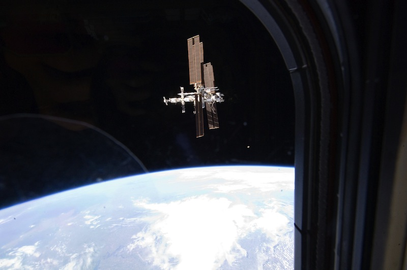 This Tuesday, July 19, 2011 image provided by NASA shows the International Space Station photographed by a member of Atlantis' STS-135 crew during a fly around as the shuttle departed the station on the last space shuttle mission. A panel of outside experts said Wednesday, Dec. 5, 2012 that NASA is adrift without a coherent vision for where it should be going. The report by the National Academy of Sciences doesn't blame the space agency. It faults the president, Congress and the nation. (AP Photo/NASA)