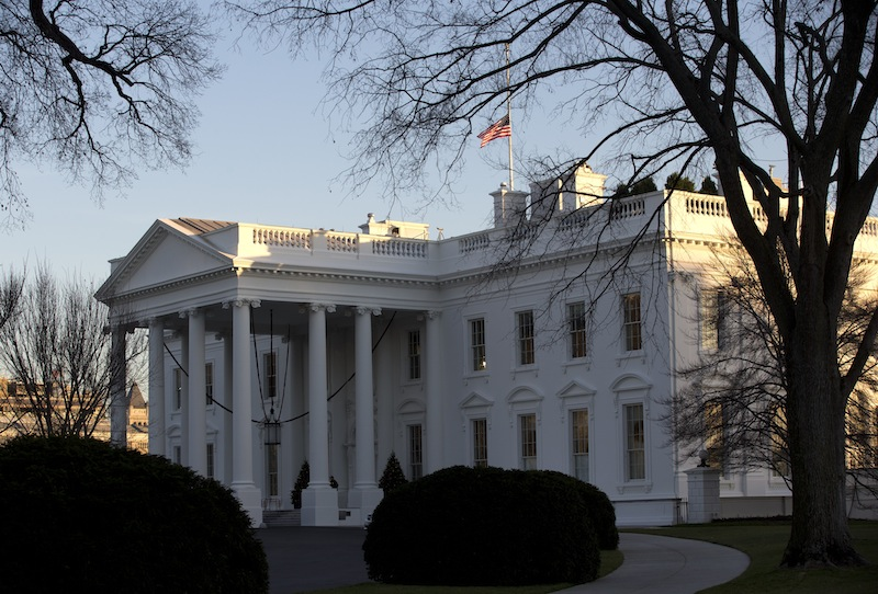 An American flag flies at half-staff over the White House in Washington, Friday, Dec. 14, 2012, in honor of the Connecticut elementary school shooting victims. (AP Photo/Charles Dharapak)