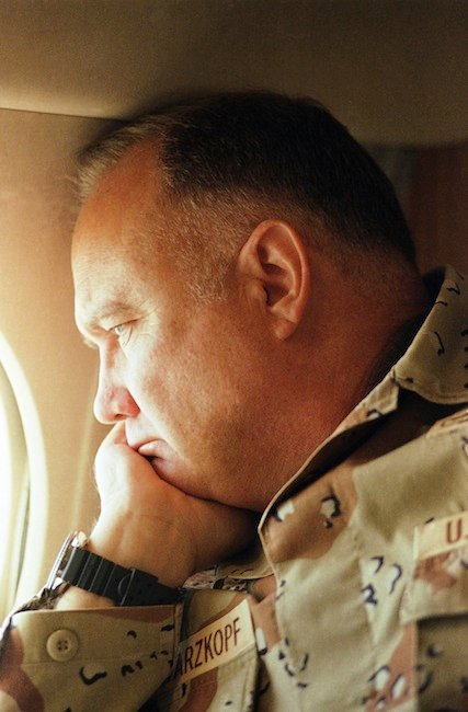 In this Jan. 13, 1991, file photo, Gen. H. Norman Schwarzkopf gazes from the window of his small jet on his way out to visit U.S. troops in the desert in Saudi Arabia.