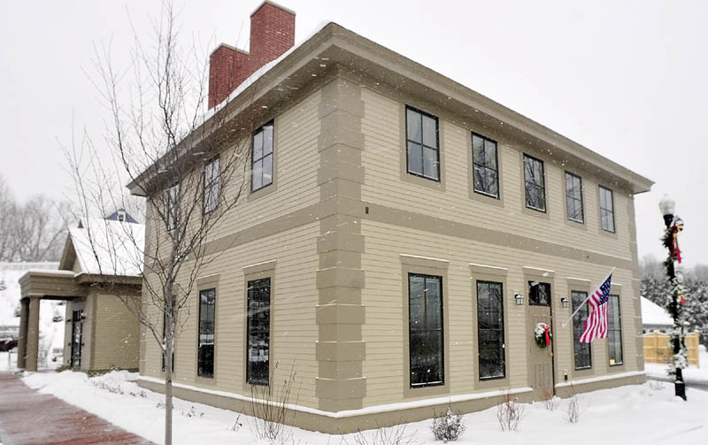 This is exterior photo taken on Wednesday December 19, 2012 of the new Kennebec Savings Bank branch at the corner of Main and Northern Avenues in Farmingdale. The building was designed to resemble the house that was demolished earlier this year on the same corner.