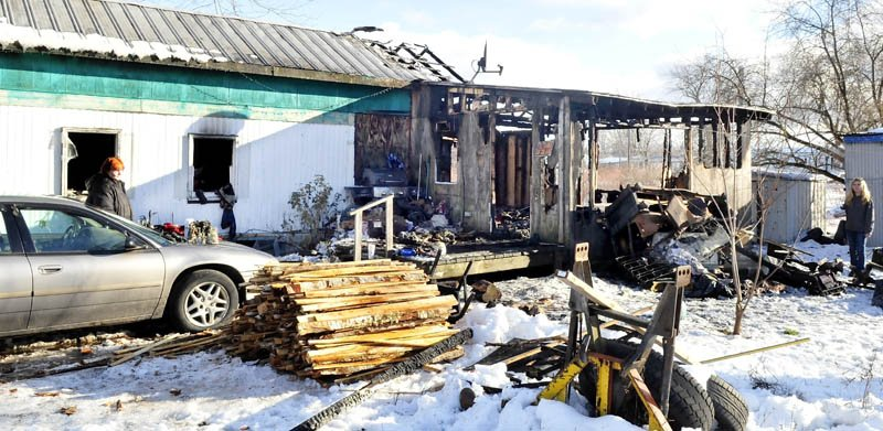 LOST HOME: Home owner Margaret Torrance, left, looks at the remains of her mobile home on Thursday, which was destroyed by fire earlier in the day. A wood stove fire caused the blaze.