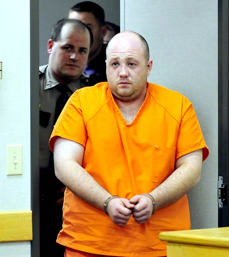 Matthew Partridge, of Winslow, is led into District Court in Waterville on Wednesday for an initial appearance in the shooting death of Justin Smith, of China, in Waterville late Tuesday evening.
