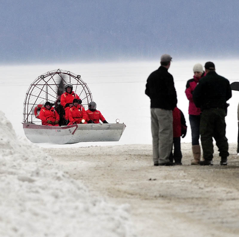 Maine Warden Service personnel return to shore in an airboat on Rangeley Lake on Monday after motoring over ice. Wardens said Dawn Newell's body was recovered Monday after the snowmobile she was riding broke through the ice Sunday night.