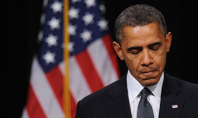 """You are not alone in your grief,"" President Obama told the residents of Newtown, Conn., Sunday. ""Our world, too, has been torn apart."""