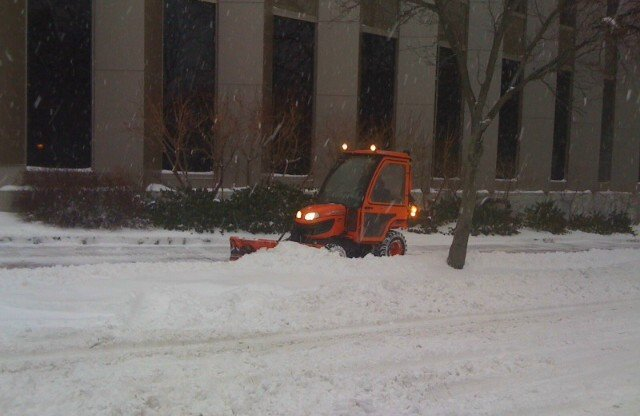 A city plow clears a sidewalk near Monument Square in Portland early Thursday morning, Dec. 27, 2012.