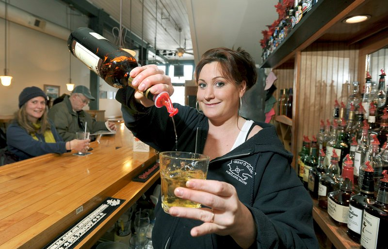 Bartender Ginny Munroe pours a VO and ginger at Andy's Old Port Pub in Portland.