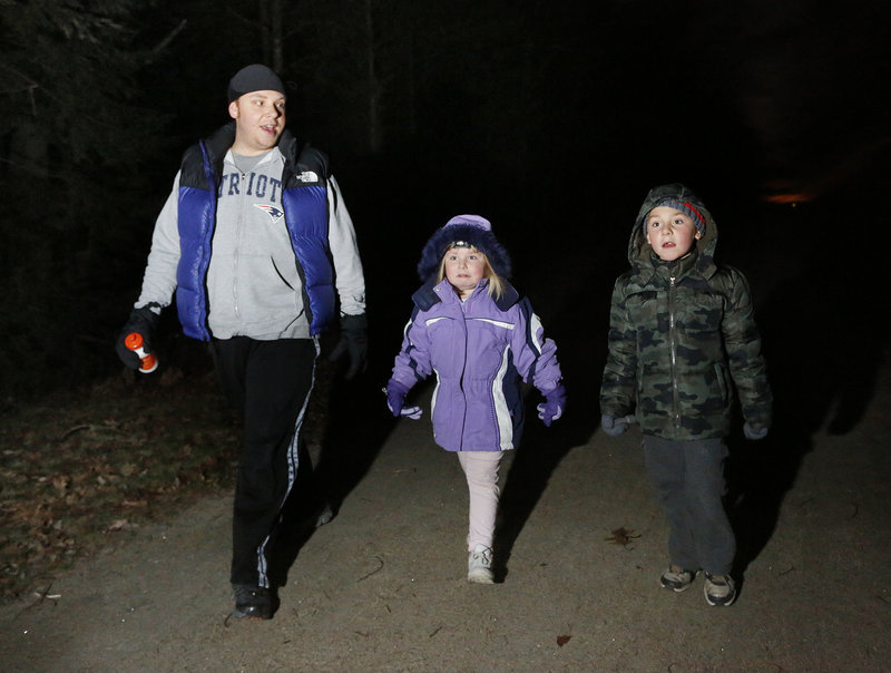 Jeremy Gray of Saco walks the trail with his children, 5-year-old Kayleigh and 6-year-old Faegan.