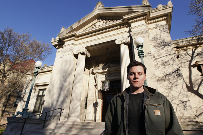 Lucas Mason-Brown stands in front of Brown University's library. Mason-Brown helped crack a code developed by religious dissident Roger Williams in the 17th century.