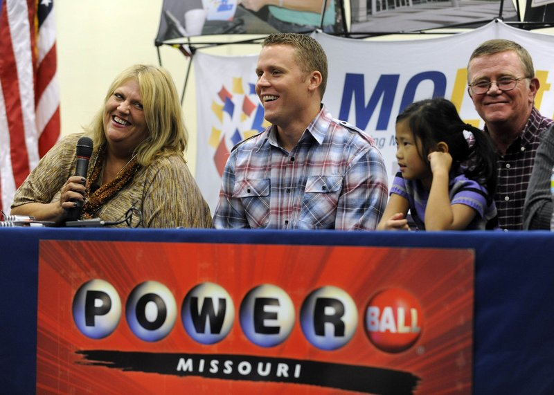 Cindy Hill talks about winning the record Powerball jackpot Friday as, from left, son Jason, daughter Jaiden and husband Mark look on during a news conference at the North Platte High School in Dearborn, Mo.