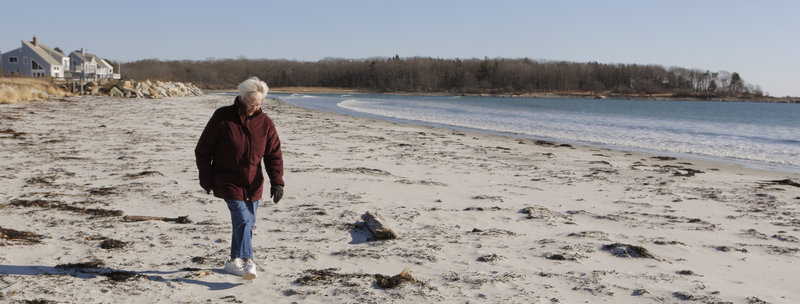 Joan Junker walks along Goose Rocks Beach in Kennebunkport on Thursday. Junker has spent every summer since 1930 at Goose Rocks and was surprised when some of her oceanfront neighbors filed a lawsuit, claiming they owned the beach.