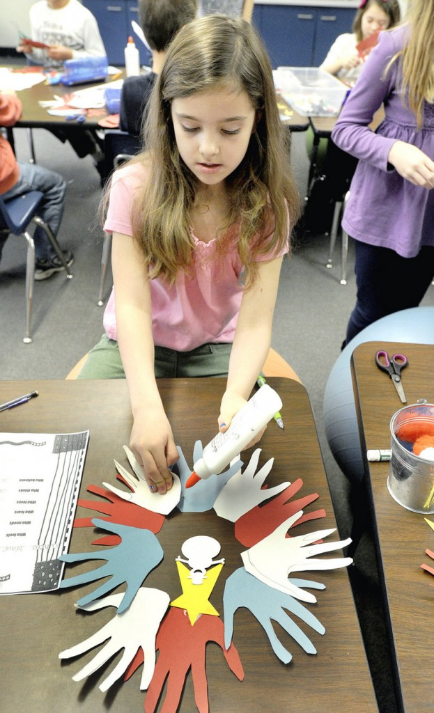 Hannah Morrison, a third-grader at Jameson School makes decorations for veterans as part of Hugs of Love.