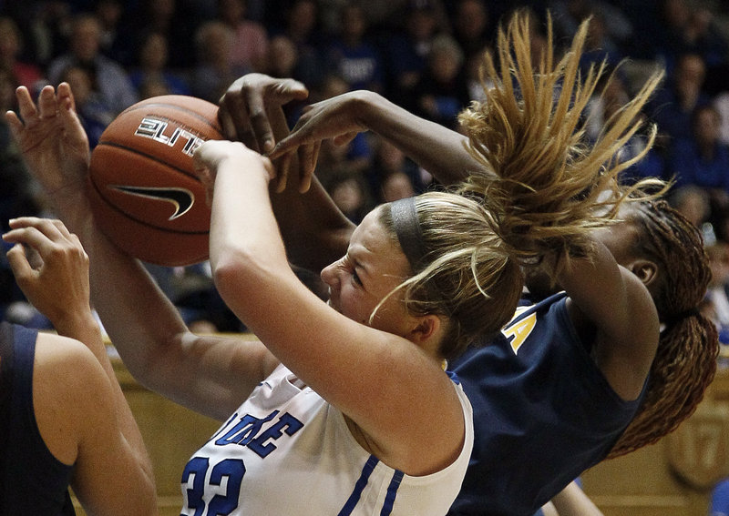 Duke's Tricia Liston, left, struggles with California's Gennifer Brandon for a rebound during the second half of Sunday's game in Durham, N.C., won by the fourth-ranked Blue Devils, 77-63.