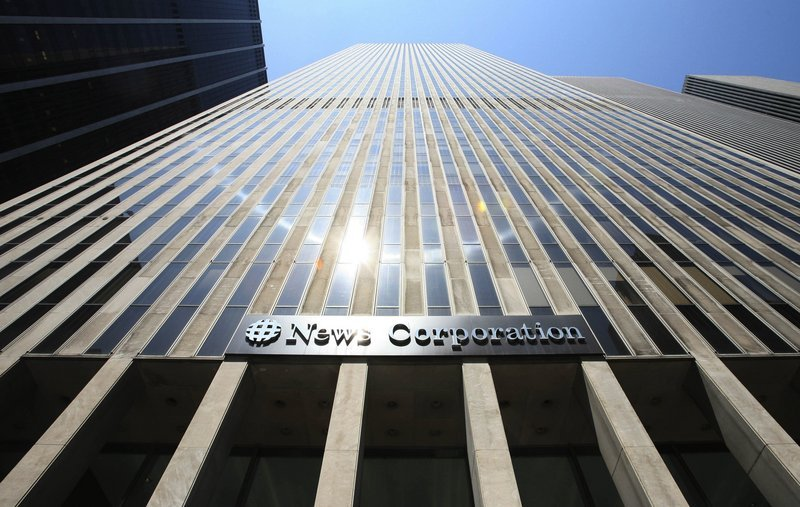 """News Corp. will remain the name of Rupert Murdoch's publishing division """"in keeping with the company's 60-year heritage of bringing news to the world,"""" Murdoch told employees."""