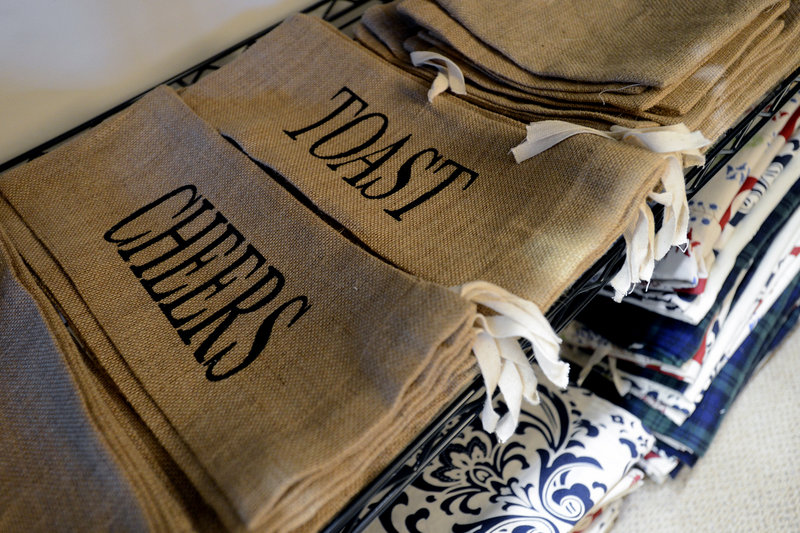 Burlap wine bags are new to Tiny Olive's offerings this year. Ivy's bags are more expensive than paper gift bags up front, ranging from $5.99 to $9.99 each, but she says they pay for themselves over time.
