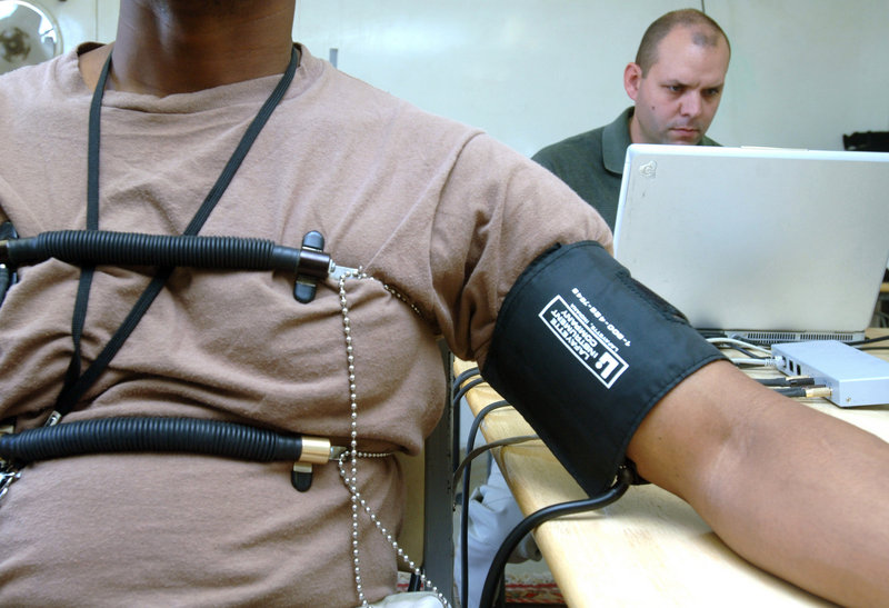 U.S. Air Force Staff Sgt. Jason Arnold, 407th Expeditionary Communications Squadron, acts as an examinee for an Office of Special Investigations polygraph examiner.