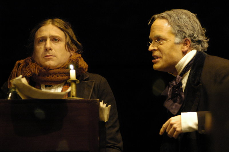 """Mark Honan, left, stars as Bob Cratchit and Tom Ford is Scrooge in Portland Stage Company's """"A Christmas Carol."""""""