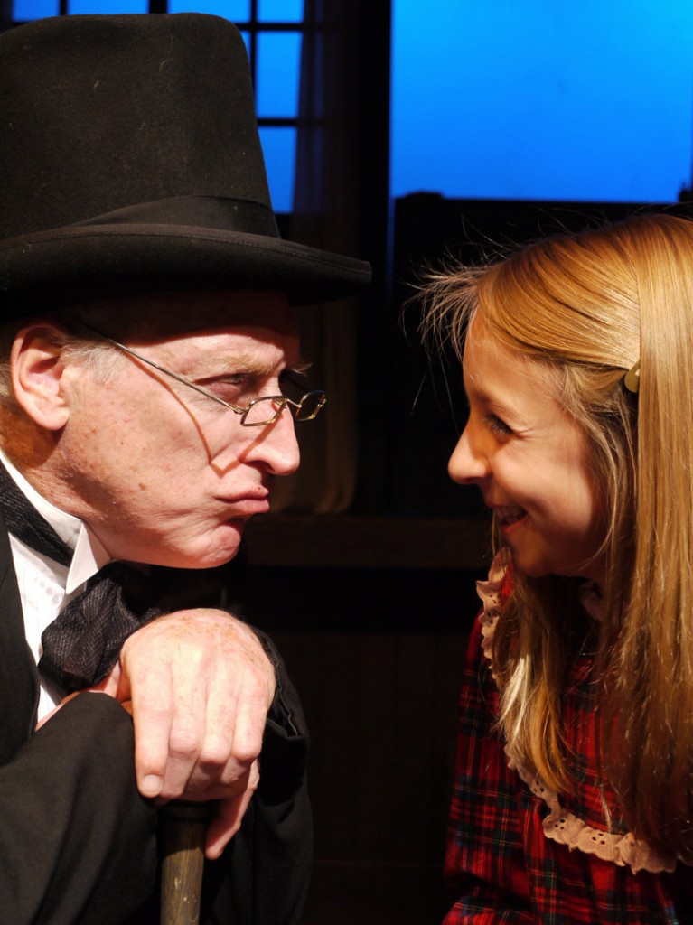 """Joel Leffert as Scrooge and Maddy Leslie as Tiny Tim in The Public Theatre production of """"A Christmas Carol."""""""