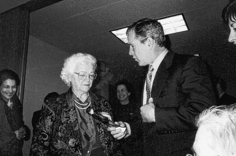 Then-President George W. Bush presents a gift of recognition to Lillian Peterson for her tireless dedication to the Salvation Army at a luncheon on March 23, 2001. Ms. Peterson has died at the age of 94.