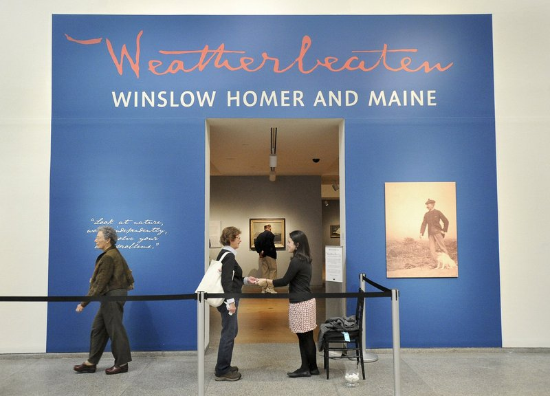 Anna Schember, right, collects a ticket at the Winslow Homer exhibit at the Portland Museum of Art. The museum hopes the exhibit draws 75,000 attendees before it closes.