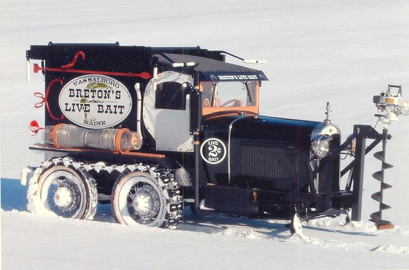 A combination snowmobile/fish-bait freezer/ice auger