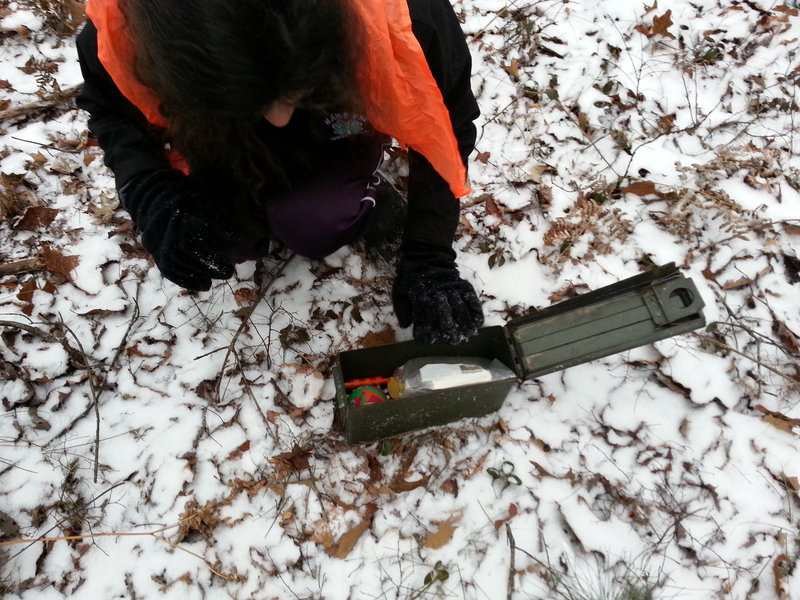 My family likes to use old metal ammo boxes for our geocaches. They require a little extra coaxing to open in the winter but are more durable than the plastic variety that many geocachers use for their hides.