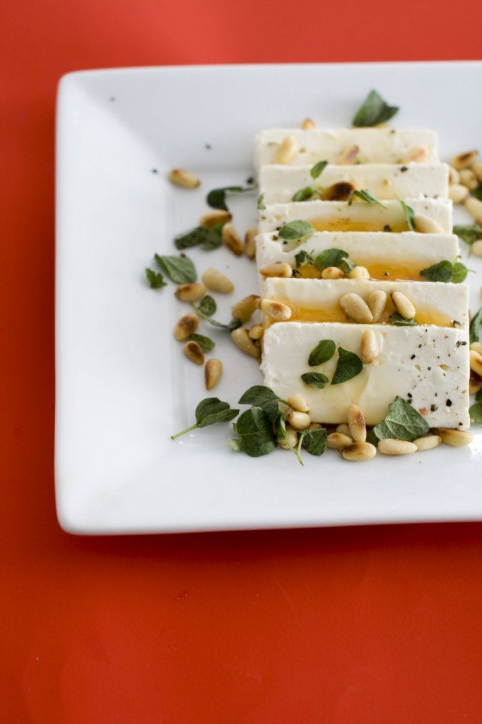 Feta cheese and honey go nicely with baguette slices.