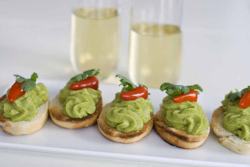 Associated Press food editor J.M. Hirsch suggests spring pea guacamole served on crackers with a Christmas sangria.