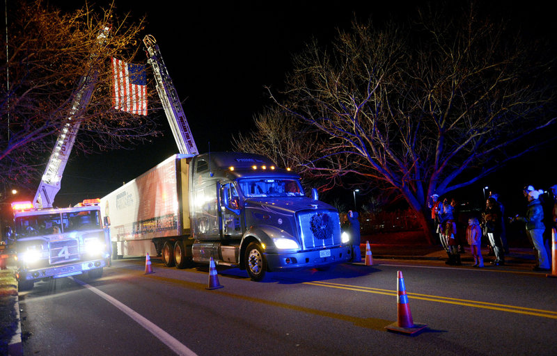 The Wreaths Across America convoy arrives Sunday at Cheverus High School in Portland. The nonprofit will deliver 30,000 wreaths to Arlington cemetery.
