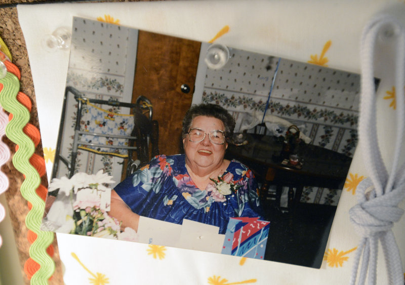 A photograph of Dot Delano, the grandmother who inspired Ivy's bag making, hangs on a board in her workshop.