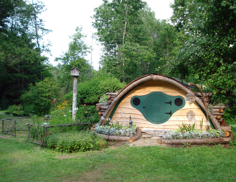 """A Hobbit Hole playhouse with natural landscaping pays homage to the homes in the Shire, from J.R.R. Tolkien's 1937 fantasy novel """"The Hobbit."""""""