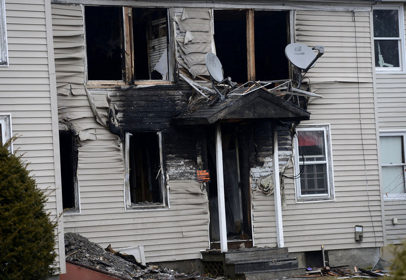 This Monday, Dec. 10 photo shows a three-unit Windham apartment building on Gray Road that was damaged by fire. The owner of the building is now suspected of setting the fire and then tying himself up to make it look like a mob hit.
