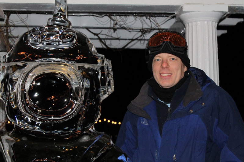 Ice sculptor Ed Jarrett with his deep-sea diver, one of more than a dozen works he created for the third annual event.
