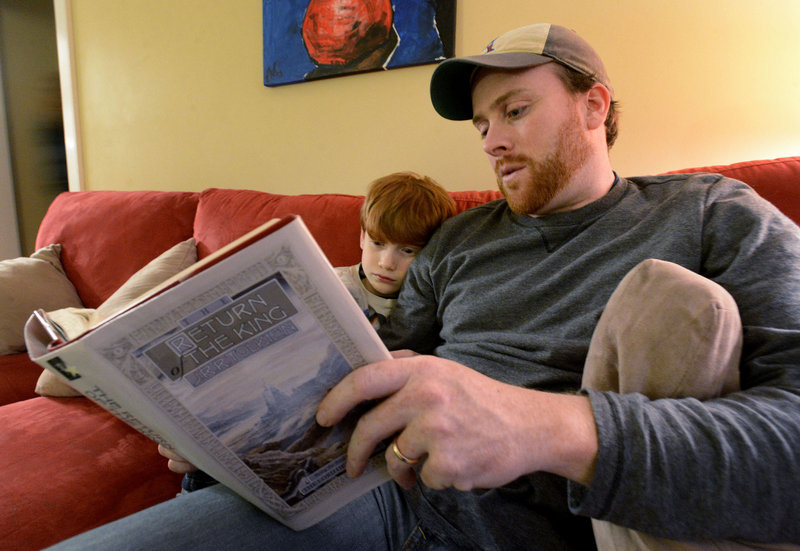 """Jeff Shaw reads to his son Brayden, 7, from """"The Return of the King"""" by J.R.R. Tolkien. They plan to see """"The Hobbit: An Unexpected Journey."""""""
