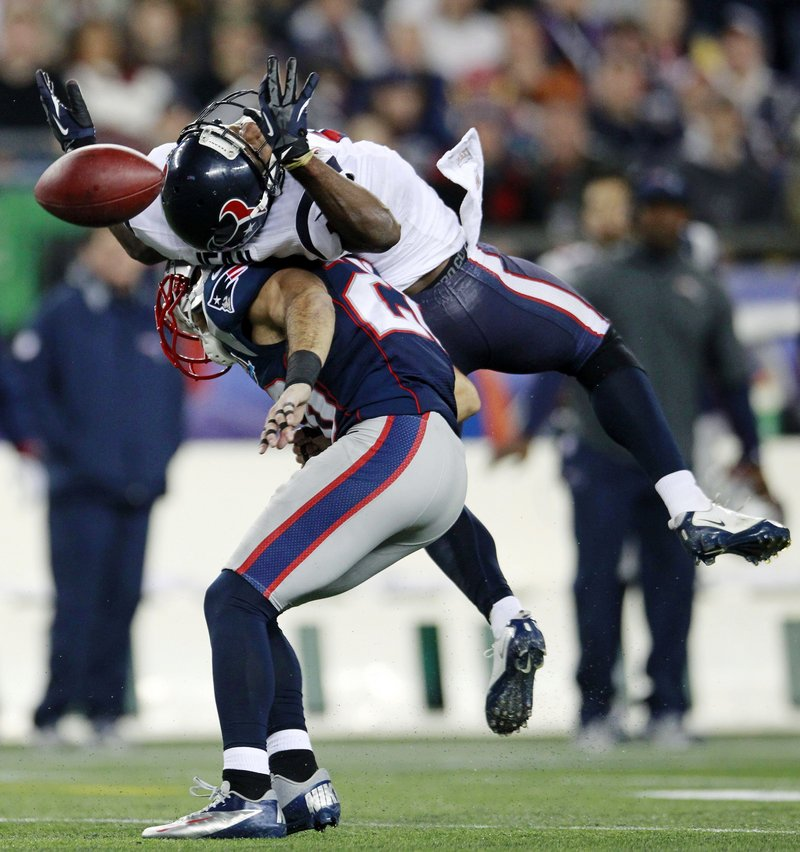 Steve Gregory, a strong safety for the Pats, breaks up a pass for Houston's Lestar Jean in the second quarter Monday night in Foxborough, Mass.