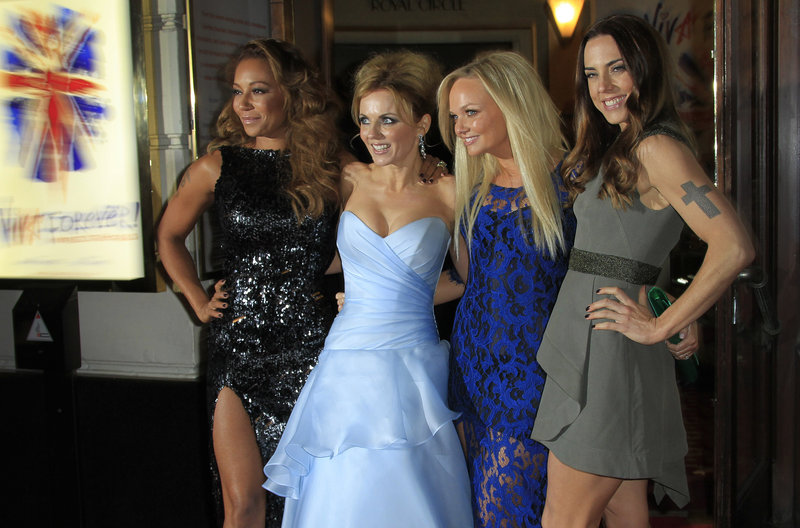 At the theater in London Tuesday, Spice Girls, from left, Mel B, Geri Halliwell, Emma Bunton and Mel C arrive for the press showing of