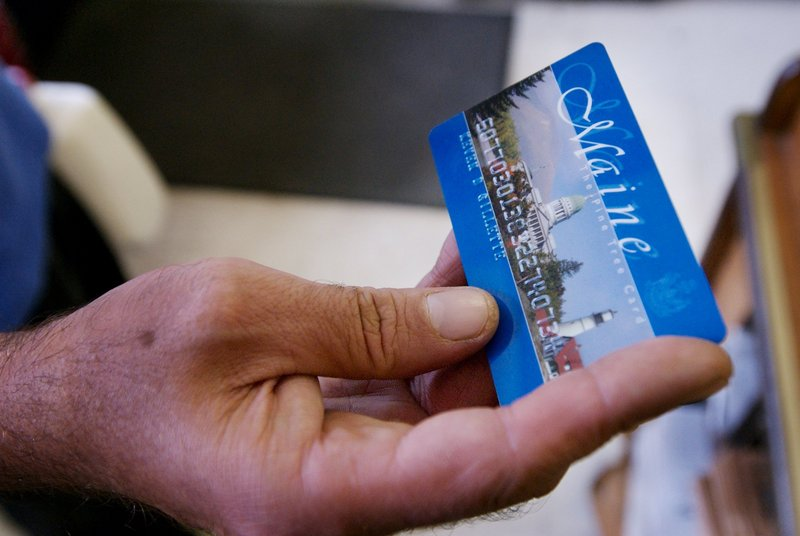 A man shops for groceries using a food stamp benefit card. A letter juxtaposing recipients of food stamps with animals
