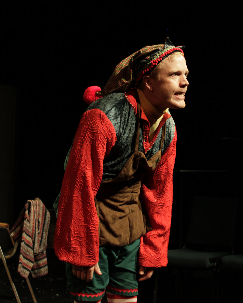 """Dustin Tucker as the disgruntled department-store elf Crumpet in """"The Santaland Diaries,"""" which concludes its holiday run at Portland Stage Company on Sunday."""