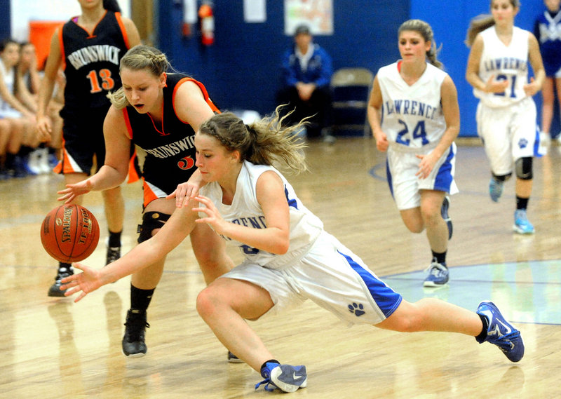Brianna Soucy of Lawrence dives Tuesday night to try and knock the ball from Erica French of Brunswick during Lawrence's 55-40 victory at home.