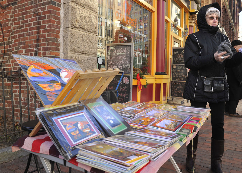 Photographer Anna Karlina has been selling her colorful, digital photos in Portland's Monument Square and the Old Port for years. The city, however, is mulling new restrictions for street-art sales.