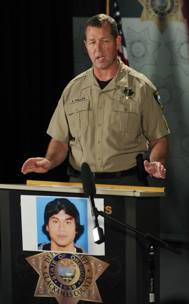 Clackamas County Sheriff's deputy Lt. Adam Phillips conducts a press conference Tuesday on the mall shooting in which a gunman killed two people then himself. Police identified the gunman as Jacob Taylor Roberts, 22, pictured below the deputy. People who knew Roberts said he was friendly and gregarious, but twice had disconnected from people close to him.