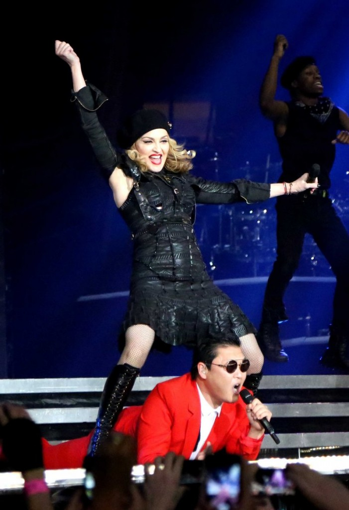 """South Korean rapper PSY, performs with Madonna. PSY's """"Gangnam Style"""" music video was second only to Whitney Houston in 2012 searches."""