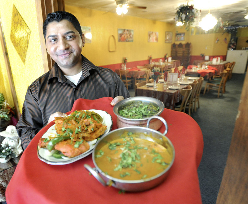 Rakesh Singh serves Tandoori Chicken, Saag Paneer and Chicken Tikki Masala during lunch at India Palace Restaurant on Congress Street in Portland. The restaurant is open daily from 11 a.m. to 3 p.m. and 5 to 10 p.m.