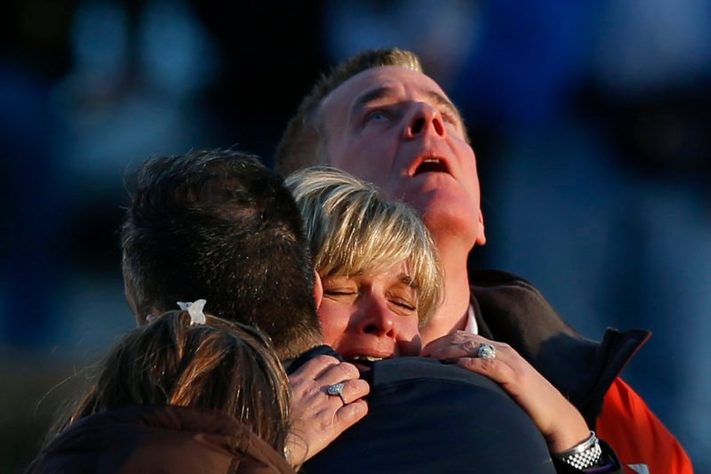 The families of victims grieve near Sandy Hook Elementary School, where a gunman opened fire Friday on schoolchildren and staff in Newtown, Conn.