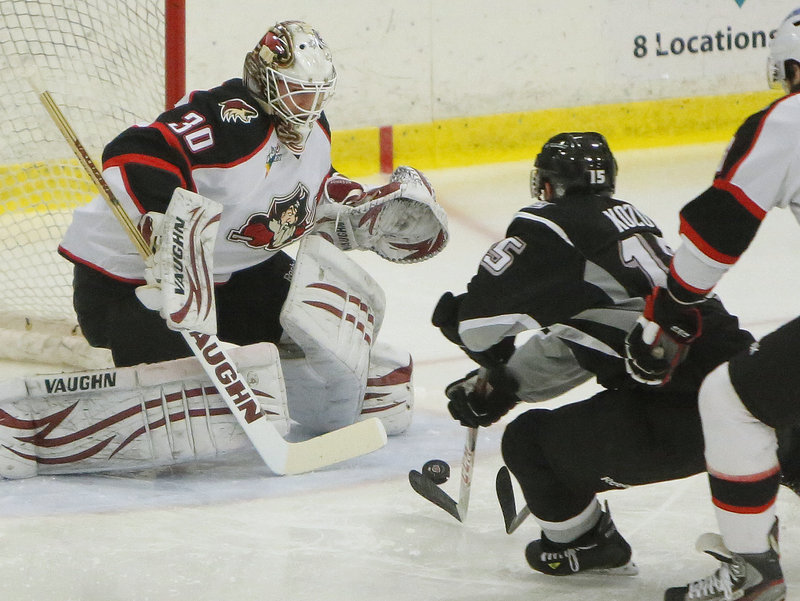 Brandon Kozun of the Manchester Monarchs prepares to shoot against Pirates goalie Chad Johnson. Johnson made the save on the breakaway bid, but Dwight King scored on the rebound.