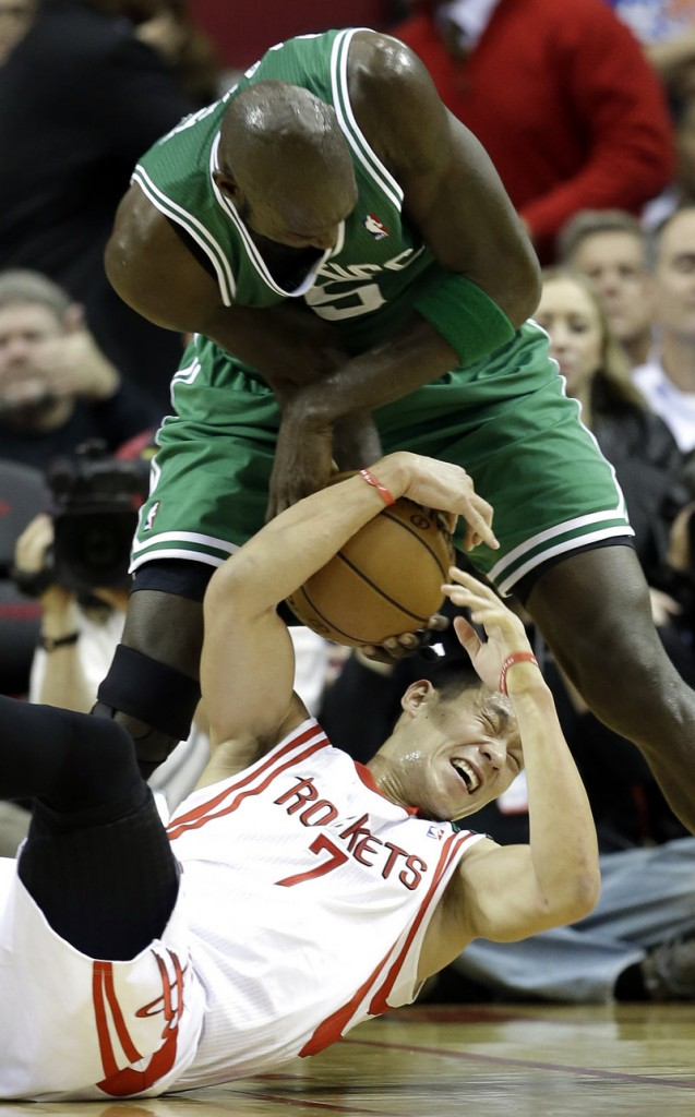 Kevin Garnett steals the ball from Houston's Jeremy Lin during Friday's game in Houston, won by the Rockets, 101-89.